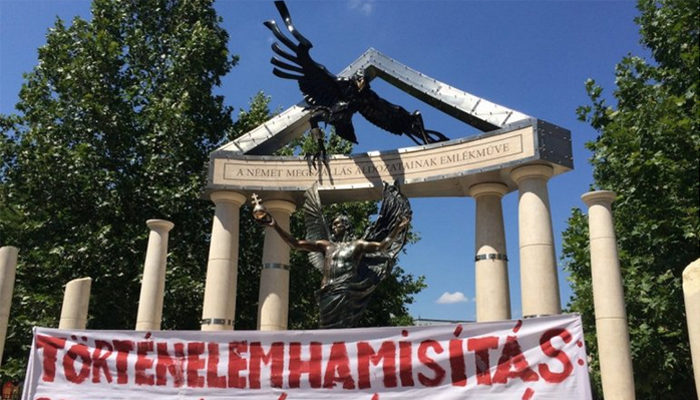 Hungarian Memorial with protest banner